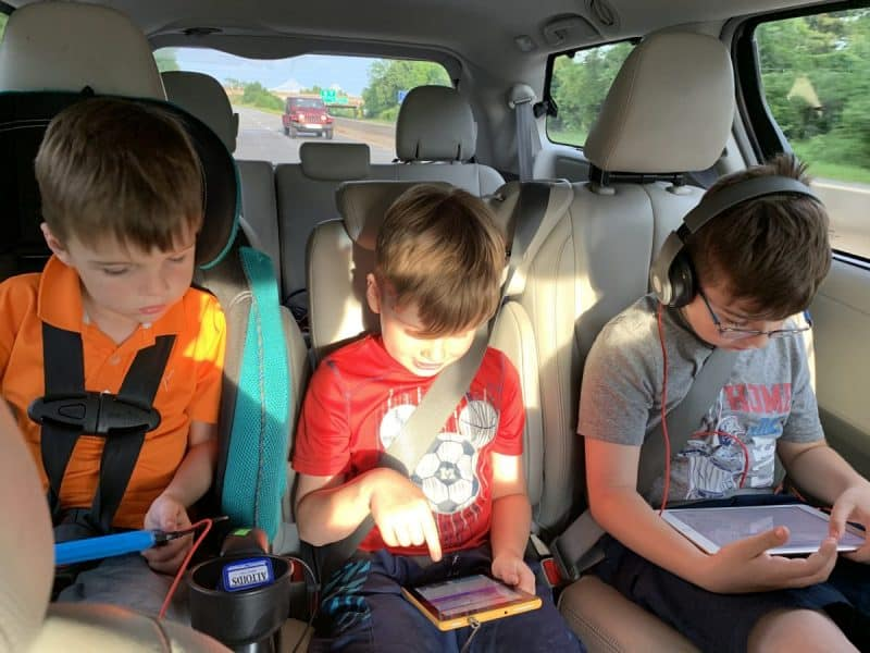Boys playing on tablets