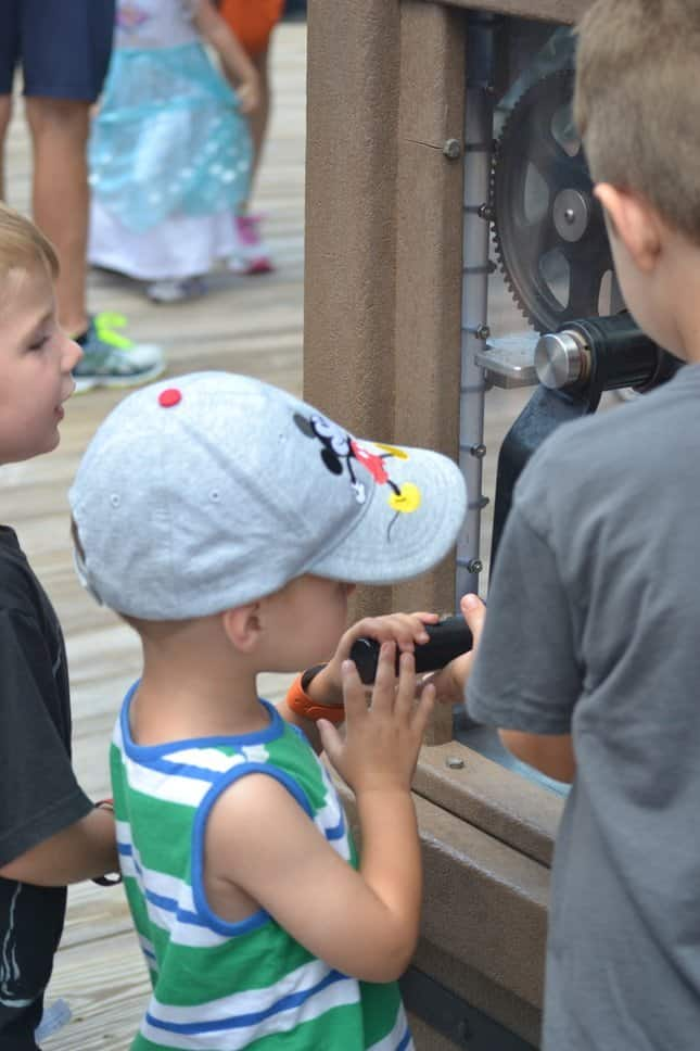 Children making pressed penny souvenirs at Disney World