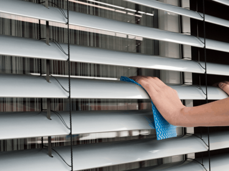 Hand cleaning window blinds