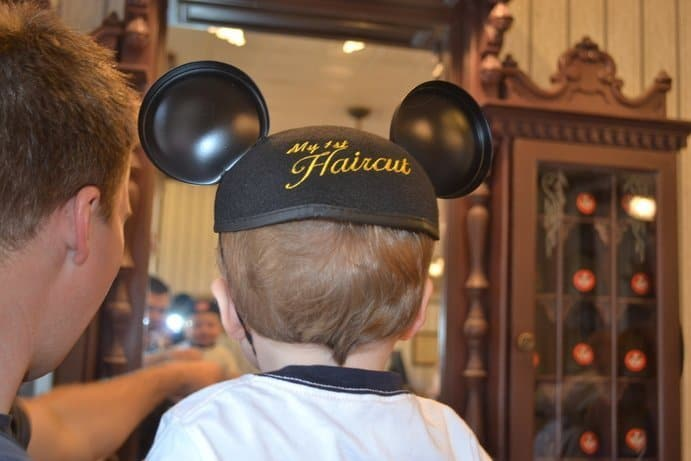 Baby wearing Mickey Ears after first haircut
