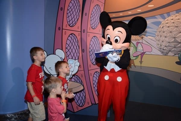 Boys getting Mickey Mouse's autograph at Disney World