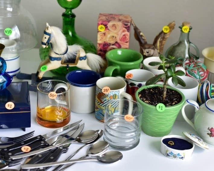 Discounted prices on home decor at a garage sale