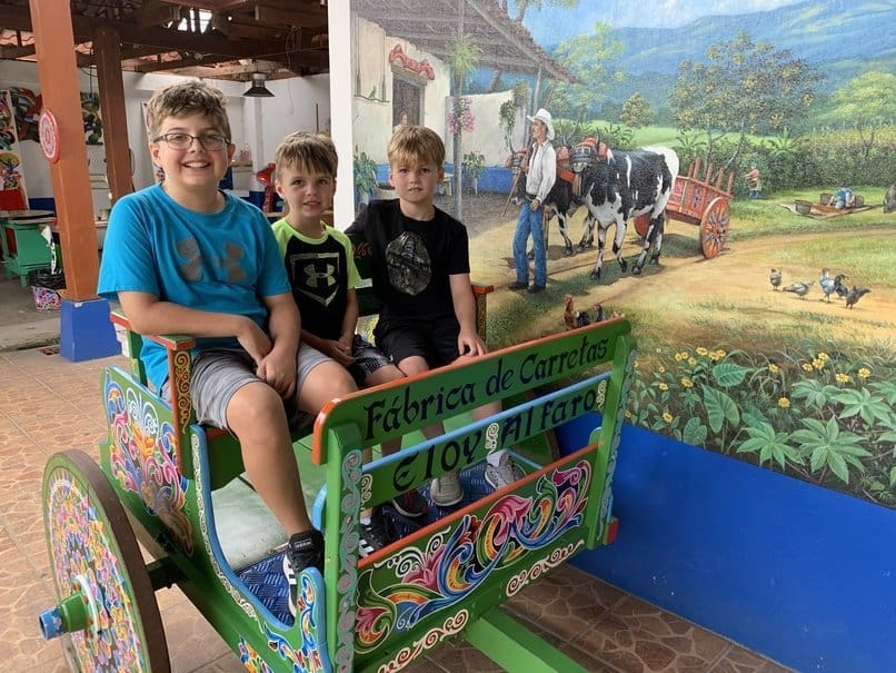 3 boys in traditional Oxcart in Sarchi, Costa Rica