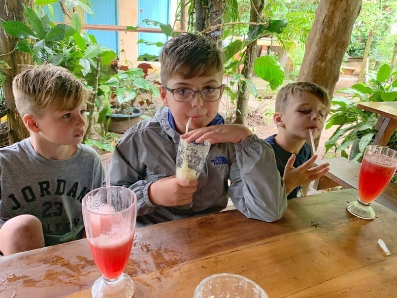 Boys drinking fresh juice at Soda Margarita's in Costa Rica