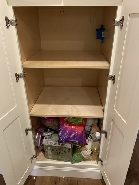 Empty pantry shelves during organizing