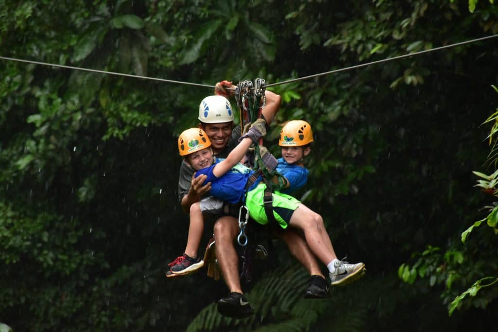 kids with zip line guide in costa rica