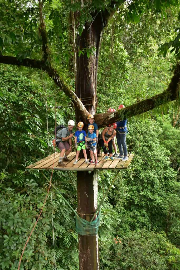 Family standing on Zipline platform in Costa Rica