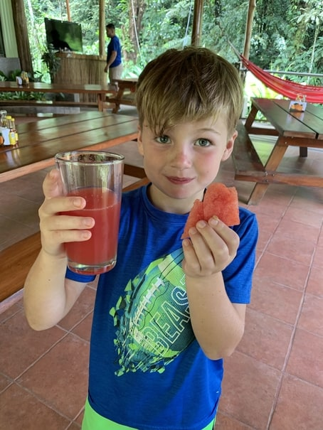 Boy eating watermelon and juice in Costa Rica