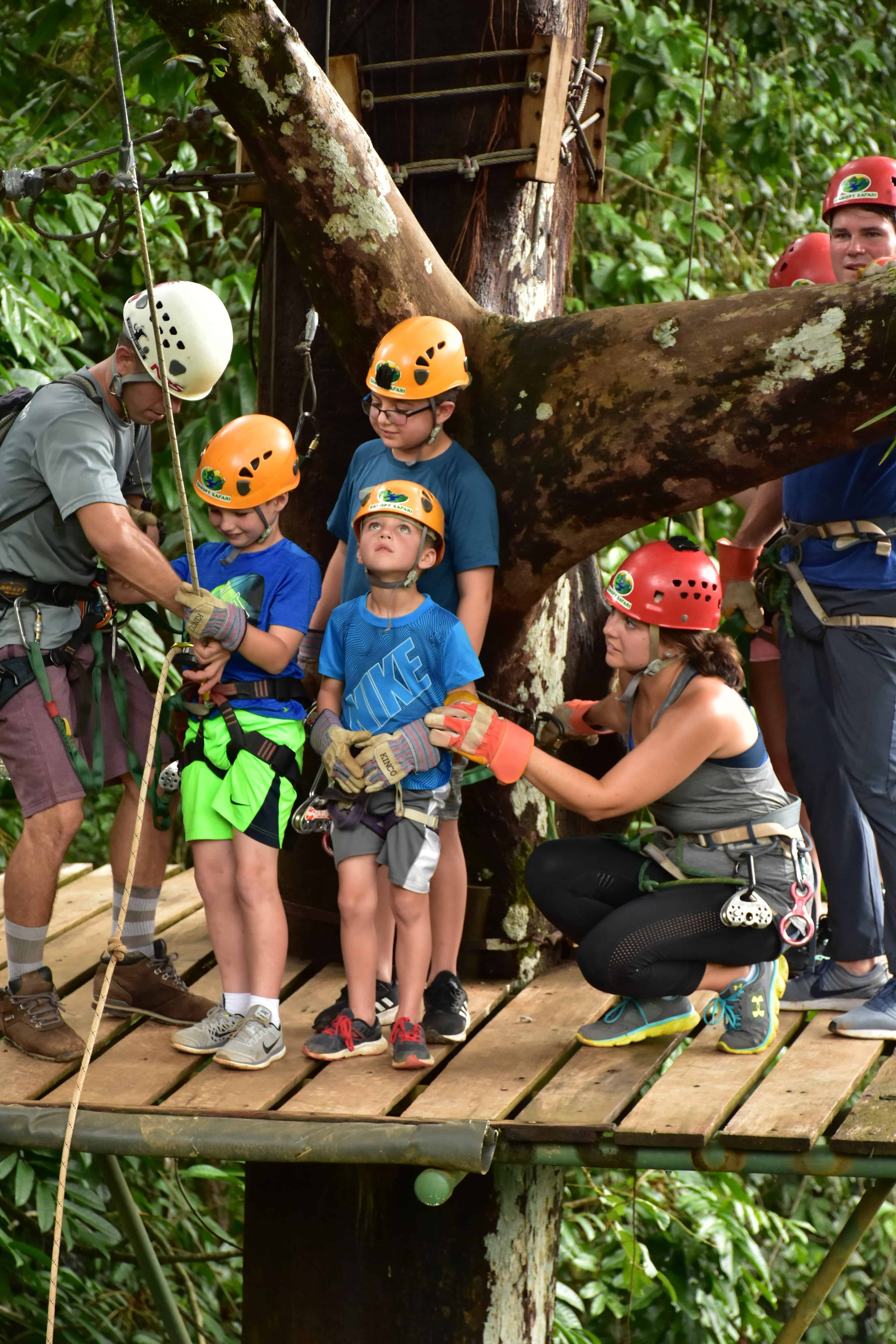Family on zip line platform in costa rica