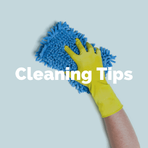 Hand wearing rubber glove cleaning with sponge