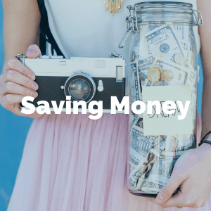 Woman holding camera and jar of money