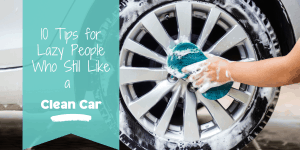 Person cleaning car tire with soapy sponge