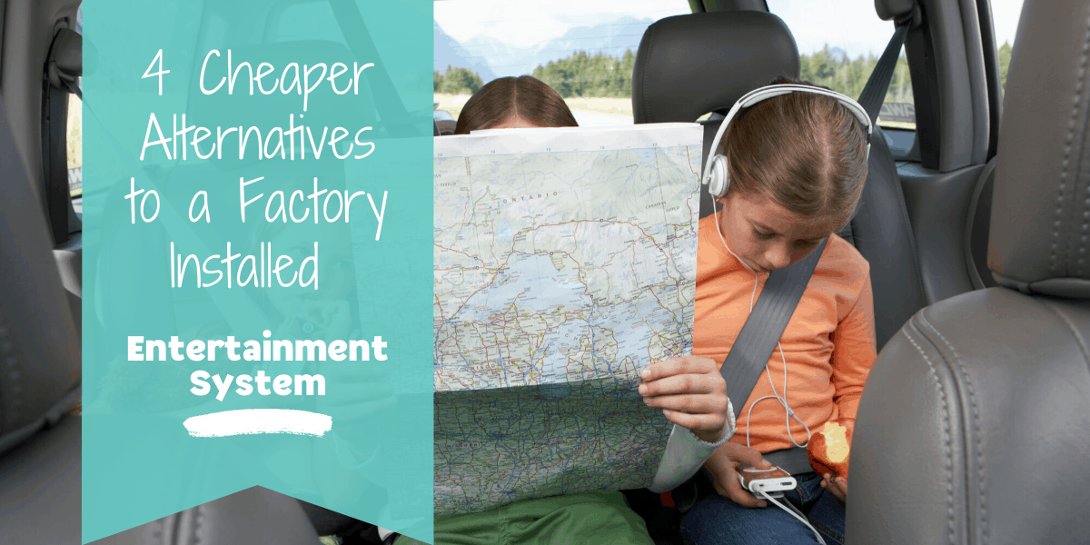 Children in the backseat looking at map and playing with electronics