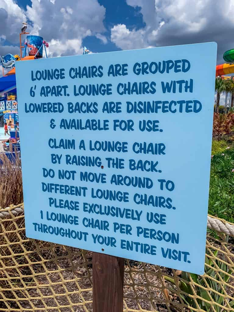 Sign at Island H2O Live water park with COVID safety precautions