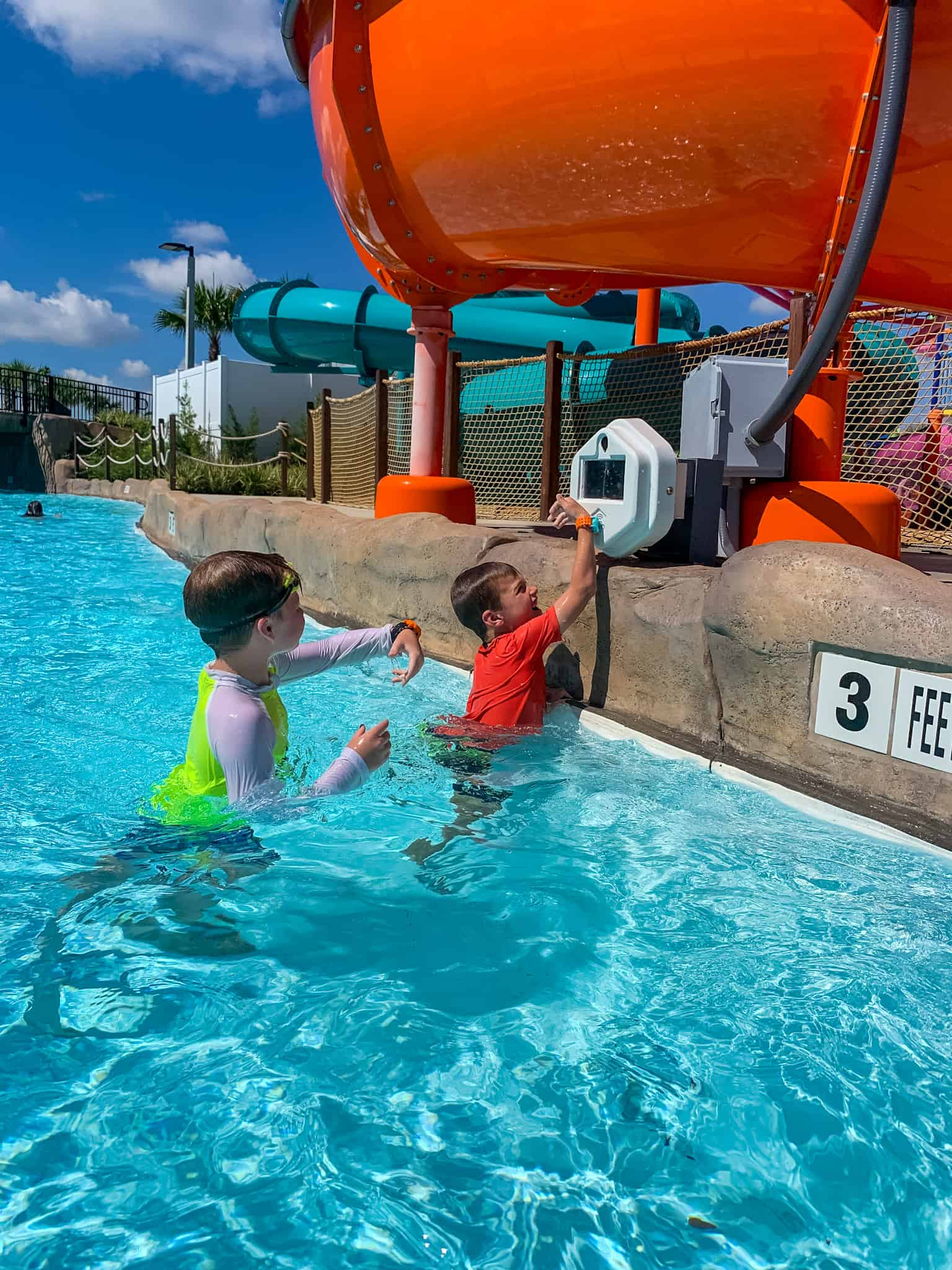 boys collecting points in lazy river at Island H2O Live water park in Orlando