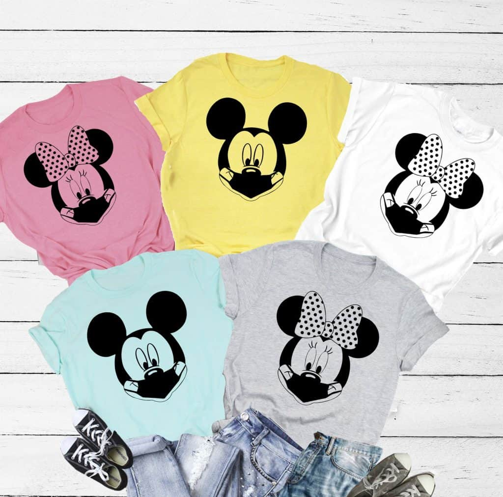 Mickey and Minnie wearing masks family shirts