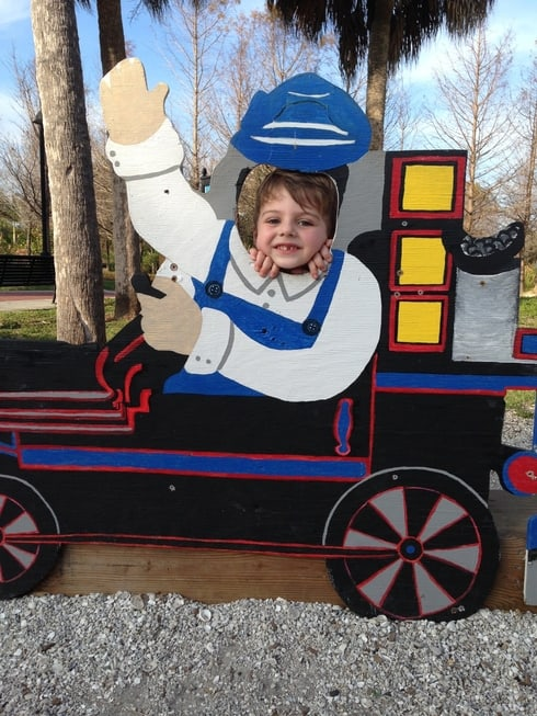 little boy in train cut out at Lakes park