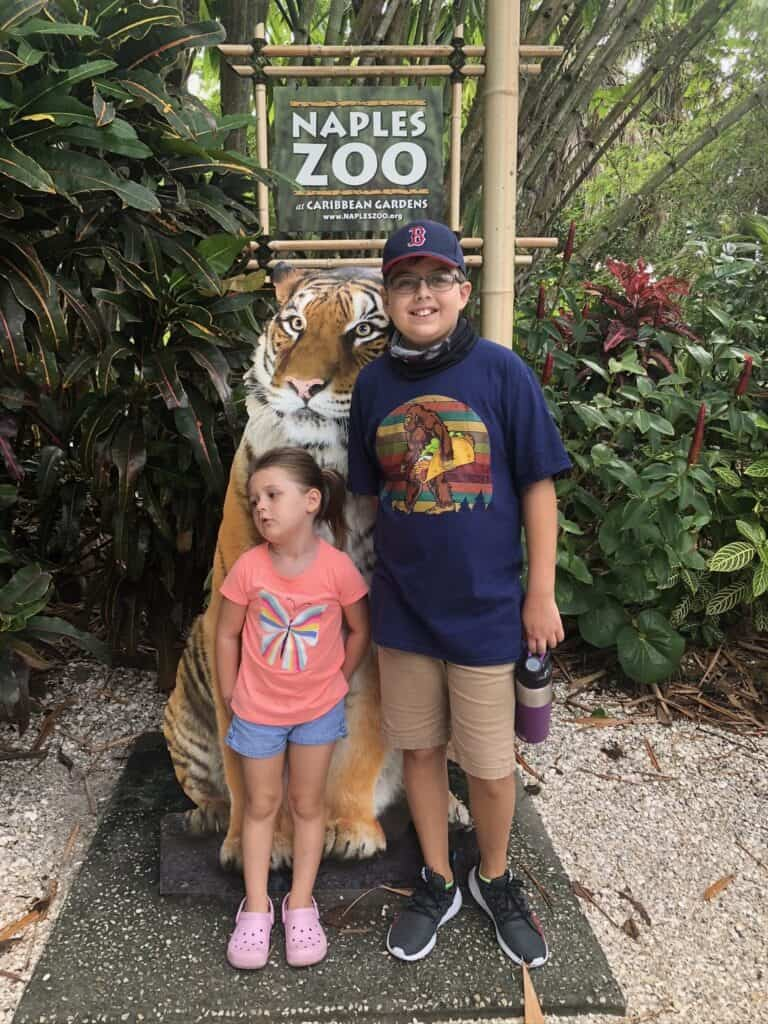 Boy and girl in front of tiger sign at Naples Zoo