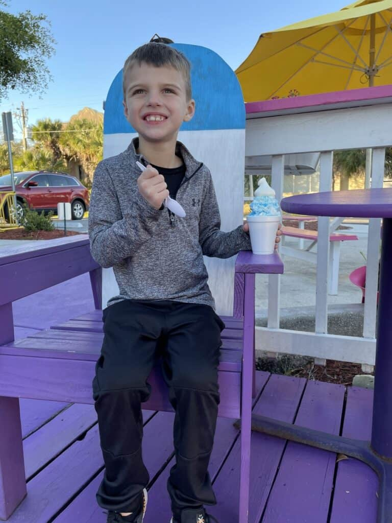 boy eating a snowball at pelicans snowballs in fort myers beach