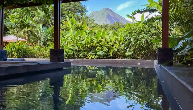 view of Arenal Volcano from pool bar at Amor Arenal