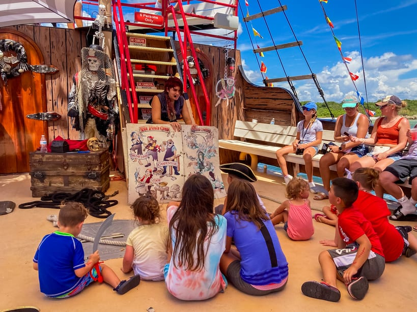 Kids getting a pirate lesson on the All Ages Pirate Cruise in Fort Myers Beach