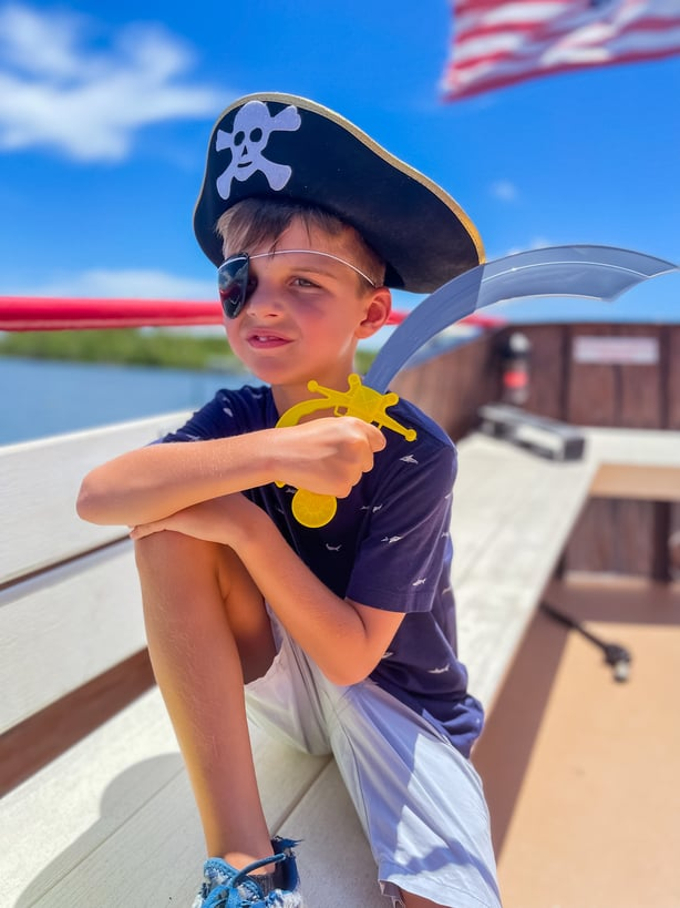 child wearing Captain Kid gear from All Ages pirate cruise fort myers